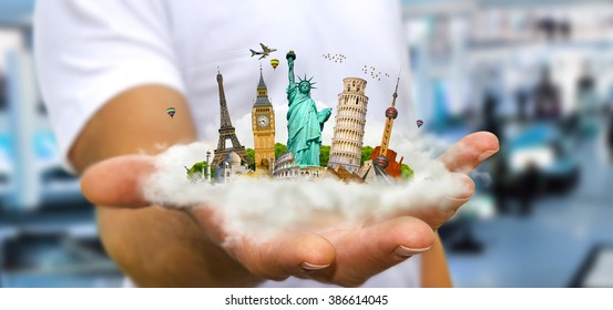 Young man holding a cloud full of famous monuments of the world in his hands