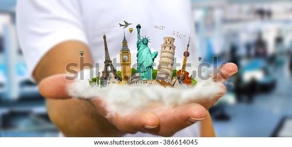 Der junge Mann, der eine Wolke voller berühmter Denkmäler der Welt in Händen hält