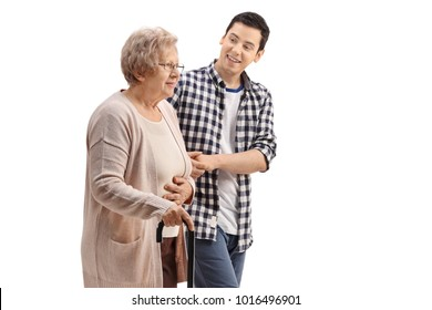 Young man holding an elderly woman with a walking cane isolated on white background