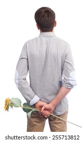 Young man holding flower in studio isolated