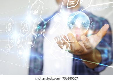 Young man holding global technology with icons. Social media concept
