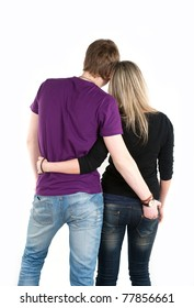 young man holding hand on girlfriend jeans