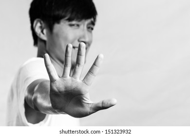 Young man holding up his hand