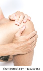 Young man holding his Knee in pain, isolated on white background