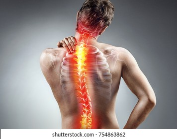 Young man holding his neck in pain. Medical concept.