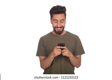 Young man holding his phone and typing, chatting with friends, isolated on a white background.