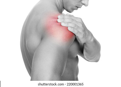 Young man holding his shoulder in pain, isolated on white background