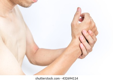 Young man holding his wrist in pain, isolated on white background
