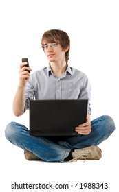 Young man holding laptop and writing sms message. Over white