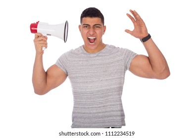 Young man holding the megaphone hearing over it screaming isolated on a white background.