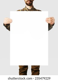 Young man holding paper