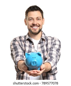 Young man holding piggy bank on white background
