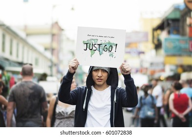 Young man holding placard for aspiration outdoor