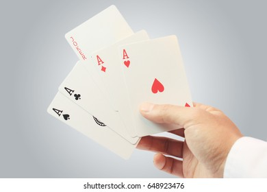 Young man holding playing cards, Joker