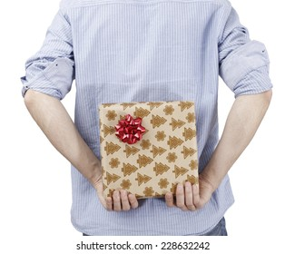 Young man holding a present in hands.