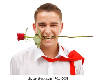 Young man holding a red rose in his mouth