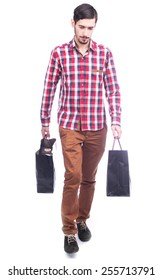 Young man holding shopping bags isolated