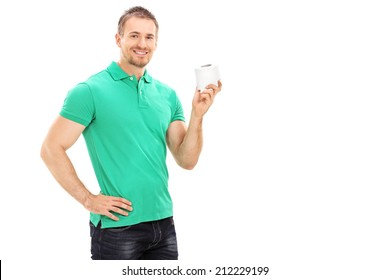 Young man holding a single roll of toilet paper isolated on white background