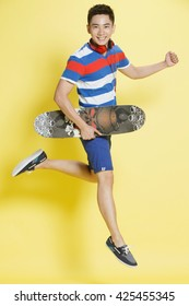A young man holding a skate