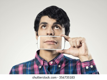 Young man holding smartphone with smile on screen