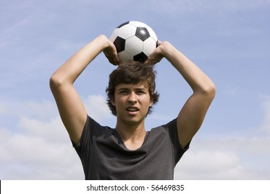 Young man holding a soccer ball