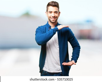 young man holding something
