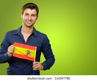 A Young Man Holding A Spain Flag On Green Background