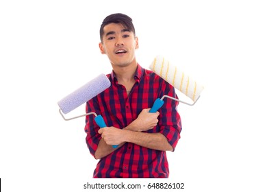 Young man holding two rolls