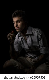 Young man holding a watch