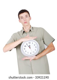 A young man is holding watch in hands