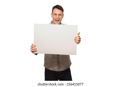 young man holding a white blank board.advertising blank banner
