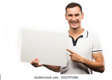 A young man holds an empty plate in his hands to fill your text. Emotional, courageous face. Isolated on white background. Copy space. Advertising, and commercial Design,