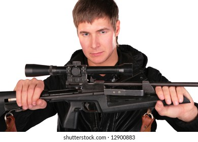 young man holds sniper gun