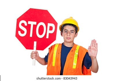 A young man holds up a stop sign together with a hand signal to stop.