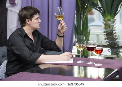 young man holds wine tasting in the restaurant