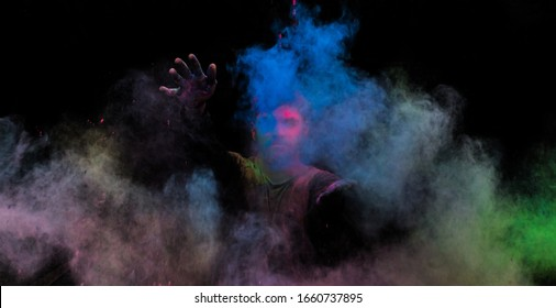 Young man in holi colors. holi is a festival of India. It is festival of colors and Joy. It is also called as Dhuleti.