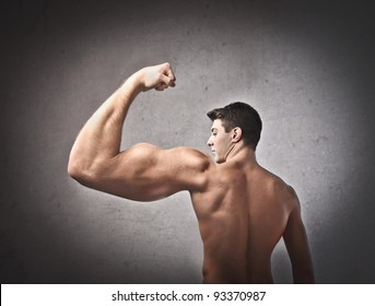 Young man with huge muscular arm