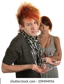 Young man with hunched shoulders and frustrated girlfriend