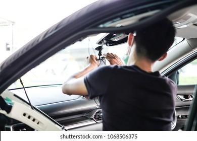 Young Man Installing  Camera