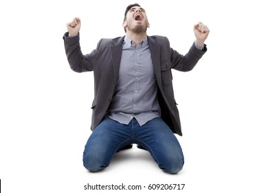young man isolated celebrating with euphoria and enthusiasm