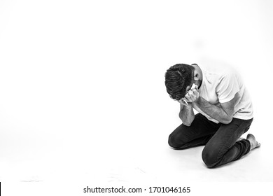 Young man isolated over background. Picture of man in depression and desperate state. Heartbroken breakdown person alone in room or studio. Failrue, sadness or shame stress.