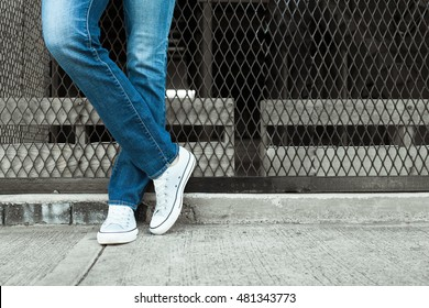 Young man in jeans and sneakers