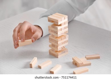 Young man with jenga at table