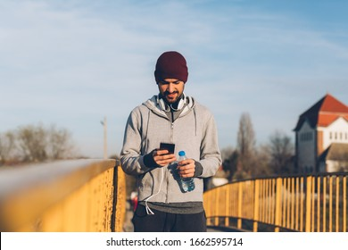 young man jogger using mobile phone