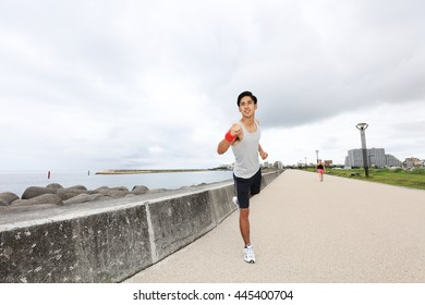 Young man jogging by the sea
