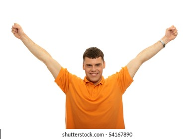 A young man joyously throws his hands up in the air. Includes the clipping path.