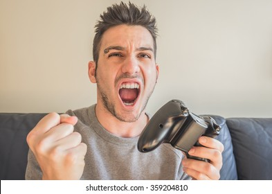 Young man with a joystick for game console
