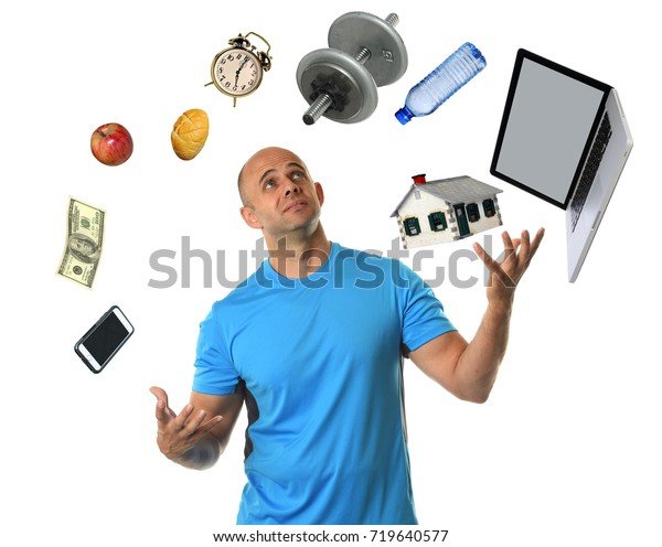 Young man juggling many responsibilities and feeling overwhelmed isolated over white background