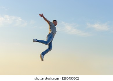 young man in a jump against a blue sky