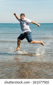 Young man jumping for fun on the beach